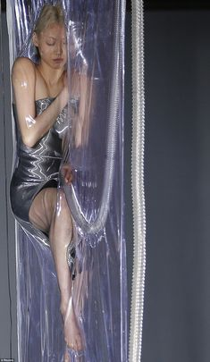 Iris van Herpen - Models suspended in vacuum packs