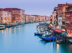 You'll be hard-pressed to find a city more romantic, beautiful, and lively at night than Venice.  Take a walk along the Rialto Bridge to see what we mean.
