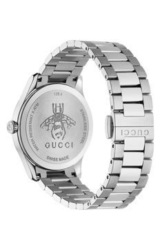 A heritage bee, a symbol of wisdom and love, lands on the dial of this Swiss-made watch shining with mixed indexes and a three-link bracelet. Style Name:Gucci G-Timeless Bee Bracelet Watch, 38mm. Style Number: 6121744. Gucci Watches For Men, Gold Watches Women, Gucci Men, Luxury Watches, Fashion Watches, Ladies Watches, Stainless Steel Watch, Stainless Steel Bracelet, Gold And Silver Watch