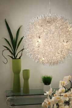 Like a thistle you blow into the wind to make a wish, the Warp Ceiling Lamp may just bring you luck. It will certainly bring you light. Made from an aluminum sh