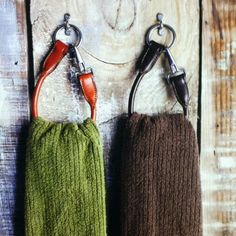 Use the throat latches from old leather halters to make unique hangers for hand towels.