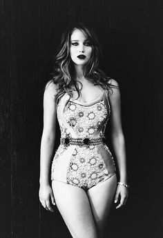 In Hollywood, I'm obese.I'm considered a fat actress. I'm Val Kilmer in that one picture on the beach. I eat like a caveman. I'll be the only actress who doesn't have anorexia rumors. - Jennifer Lawrence