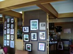 coffee shop with art selling kiosk within