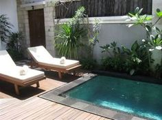 small plunge outdoor pool with a wooden deck