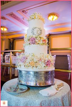 Gorgeous wedding cake with tons of colorful sugar floral! Cake by Elysia Root Cakes. Photo by Studio This Is #wedding #weddingcake #cake #cakeinspiration #weddinginspiration #chicago
