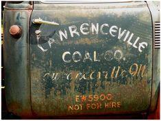 Old, worn hand-lettering on a truck door. #OldBatteriesPictures