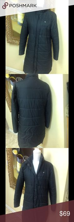 Lacoste Black Down Coat Size 40 Classic black long down coat by Lacoste designed in France. Great condition, measures 35 inches in length, silver logo on front, supper and snaps closure, classic style, low price. Questions feel free to contact me. Lacoste Jackets & Coats Puffers