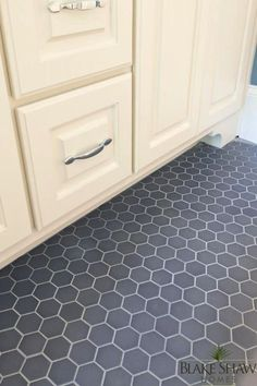 source: Blake Shaw Homes Gorgeous detail shot of gray hexagonal tiled bathroom floors with creamy