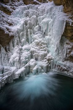 What appears to be frozen waterfall actually has a river still running behind it.  - photo by Kathleen Croft, via Your Shot, National Geographic (1/09/17);  Banff National Park, Banff, Alberta, Canada