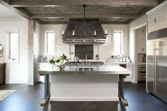 Kitchen - pewter and carrara countertops, custom-designed zinc hood, French Lacanche range, antique iron fireback behind range, Shaw Original farmhouse sink, Perrin and Rowe faucets, leaded glass windows, brick ceiling, SubZero and Miele'.