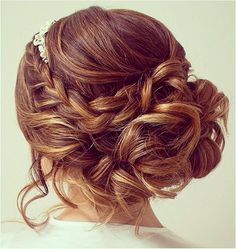 Cute braided messy bun. Great look for weddings and other formal events.