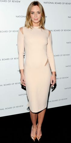 Emily Blunt vamped it up at the National Board of Review Awards in a stretch wool Emilio Pucci cocktail dress and pointy-toe Stuart Weitzman pumps.