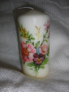 Candle with wild flowers.