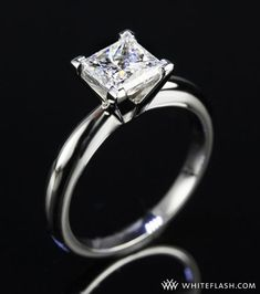 Princess cut diamond Tiffany engagement ring.