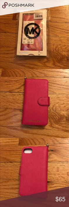 Michael Kors IPhone 7 Folio Case Rasberry Like new, literally used this for one day. Made for the IPhone 7, but will fit the IPhone 6/6s as well. Raspberry color. Card slots and back slip pocket. Magnetic closure. D ring to attach a wristlet strap. Comes with all original packaging. Michael Kors Accessories Phone Cases