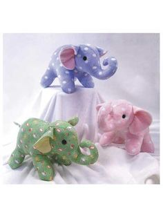 """Pick playful cotton or flannel fabric and use the easy instructions to stitch these 7 1/2"""" soft-sculpture stuffed animal patterns! The Ellie and Elwood Elephants Pattern stitches up into the perfect gift for your favorite little one. Or give as a DIY baby shower gift for the mom-to-be."""