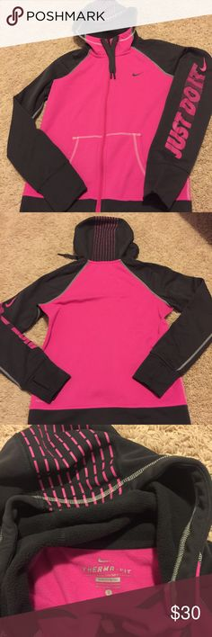 Nike Therma-Fit Zip-Up Hoodie So cozy, warm, and CUTE! Therma-Fit zip-up hoodie in a bright pink and grey. Great condition, no holes, stains, or piling! Thumb holes in the sleeves to help keep your hands warm! Nike Tops Sweatshirts & Hoodies
