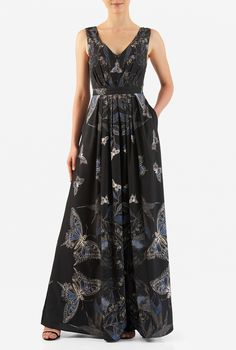 Butterfly print crepe flows with the angular pleated bodice and knife-pleat skirt of our comfortable, any-occasion dress.