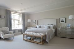 Spacious Bedroom With Wide Nightstands And Grey Bed Near Tufted End Of Bed Bench