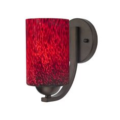 Bronze sconce with red art glass shade.