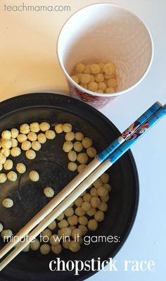 Minute to win it games are great for family fun night, birthday parties, or classroom parties and whatever else!  There's a ton of FUN along with math and movement with this minute to win it chopstick race game. It's an easy minute to win it game to include in your next family fun night or party! #teachmama #minutetowinit #familygame #minutetowinitgames #gamesforkids #classroomgames #classroomparty #gamesforkids #kidsactivities