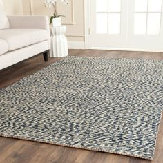 NF448C Rug from Natural Fiber collection.  This casual area rug is made using innately soft and durable natural fiber yarns, with subtle, organic patterns created by a dense sisal weave. Room decor takes on a warm, homey aspect with the distinctive look and comforting feel of this natural fiber floor covering.
