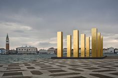 Gold Columns at The Venice Biennale by Alessandra Chemolio