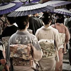 Japanese traditional kimono. This image has a big contrast with the harajuku look. And that is what happen in Japan - a country famous by the people and although Japan is one of the most modern industry country but they are still keep traditional beauty and value.