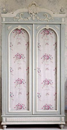 French designed closet.  Think i would take out the pink-patterned inlay and put in a more fitting pattern, or just put glass panels there instead.