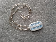 Customized name keepsake w/ sweet feet on opposite side ~ #cofbeads #polymer 2014