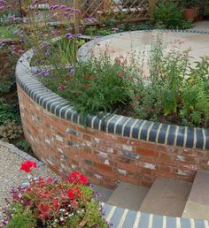 Bullnose blue brick, with old mill brick Brick Wall Gardens, Brick Garden, Garden Pond, Easy Garden, Garden Paths, Garden Steps, Garden Borders, Garden Landscape Design, Garden Landscaping
