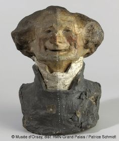 Honoré Daumier, (1808-1879), Bust of Charles Philipon, a.k.a. The Toothless Laugher, (undergoing restoration), © Musée d'Orsay.  C. 1832, Coloured unbaked clay, H. 16.4; W. 13; D.10.6 cm  Daumier made around 40 busts of the 'Juste Milieu,' of which 36 remain. Philipon was the owner/editor of the satirical magazine, Le Chiavari, which produced most of Daumier's lithographic caricatures during his lifetime.