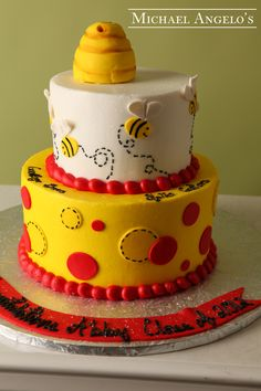 Buzzing Bee #46Animals This design is made of two round tiers in yellow and white buttercream. Fondant polka dots were added on the bottom tier. The top tier has miniature bees flying all around the cake. The bee hive on top is also hand made from gum paste.
