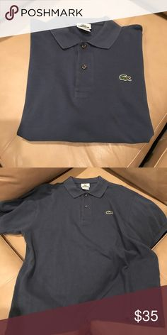 Men's Lacoste Classic Polo Dark Steel Blue Color This is Size 5 (Medium) in very good condition. I take good care of all my clothes. They are preloved! Lacoste Shirts Polos