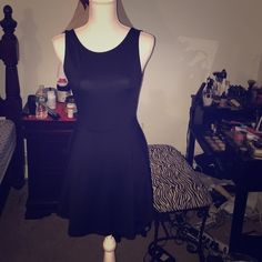 H&M v neck back dress Worn once. Knee length black simple dress. Back is a V shaped and this dress is in perfect condition. Casual or dressy ! Fabric is stretchy as it is polyester and elastane. H&M Dresses