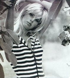 Brit Ekland in striped top.