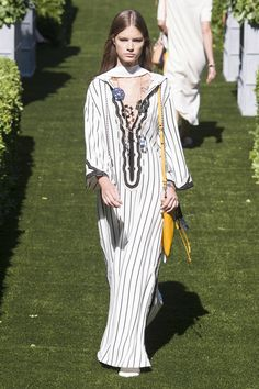 tory burch white tunic with black vertical stripes and black embroidery at neckline, worn with long necklaces