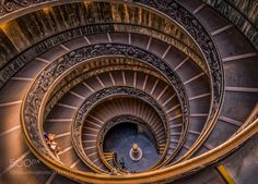 "Bramante - The modern double helix staircase and commonly referred to as the ""Bramante Staircase"" was designed by Giuseppe Momo in 1932 and was inspired by the original Bramante Staircase. This staircase like the original is a double having two staircases allowing people to ascend without meeting people descending; as with the original the main purpose being to allow uninterrupted traffic in each direction. It encircles the outer wall of a stairwell of approximately fifteen meters wide and…"