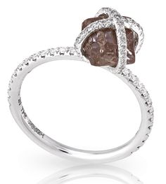Stunning chocolate brown rough diamond only enhanced but the micro pave holding it tight.