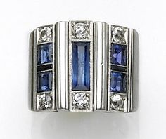 Art Deco sapphire & diamond ring, 1930s, the wide band featuring three geometric style panels of square & rectangular-cut sapphires & small synthetic sapphires bordered by old European-cut diamonds; mounted in eighteen karat white gold.