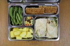 Burrito, Pinnapple, Snap Peas, Granola Bar and Chocolate covered Sunflowers