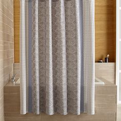 Loving the immediacy and irregularity of hand-drawn designs, Genevieve Bennett has created a stunning motif of fine lines and playful dots just for us in tonal blues on white preshrunk cotton. The Torben shower curtain is also available in a palette of yellow and grey.