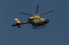 Police Helicopter Helps Search for Assault Suspects
