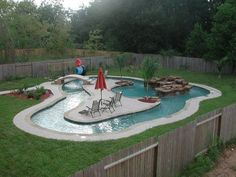 Garden and Patio, Small Backyard Lazy River Pool With Lounge Area In The Middle Plus Stone Waterfall Surrounded By Green Grass And Wooden Fence Ideas ~ Backyard Lazy River Lazy River Pool, Backyard Lazy River, Nice Backyard, Pool In Small Backyard, Dyi Pool, Backyard Barn, Backyard Layout, Pool Fun, Small Pools