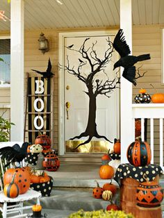 Very Cute Spooky Entry Way with Painted Pumpkins in Black & Orange, Crows and a Dead Tree Focal Point on the Front Door!  Fab!