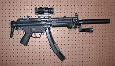 H&K MP5, silenced w/tactical light and extended clip. Not sure what the scope is for, this is a close-range dominator.