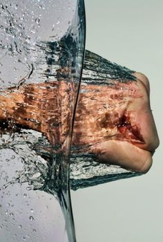 Reminds me of a photo he showed of a swimmer coming out of the water just before the surface tension broke.