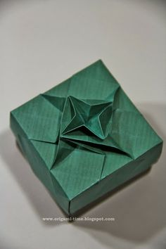 Origami Masu box with tessellation technique.  Link to video instructions for this lid.