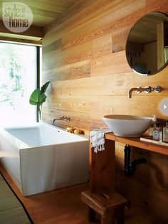 Serene spa Every day is a day at the spa in this bathroom, thanks to the floor-to-ceiling cedar planks, streamlined tub, and humble faucets.