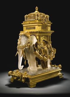 Molded, blown, frosted and pearlized cut crystal elephant liqueur set with gilt-bronze mounts, its palanquin in the form of an Indian temple containing decanters and goblets - Baccarat, circa Baccarat Crystal, Glass Art, Cut Glass, Elephant, Auction, Indian Temple, Jewelry, Clocks, Fancy Chair